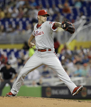 Photo - Philadelphia Phillies' A.J. Burnett pitches against the Miami Marlins in the first inning of a baseball game in Miami, Tuesday, May 20, 2014. (AP Photo/Alan Diaz)