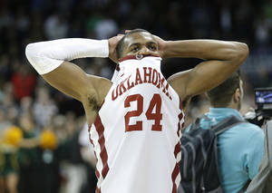 Photo - Oklahoma's Buddy Hield (24) reacts after loosing to North Dakota State in overtime during the NCAA men's basketball tournament game at the Spokane Arena in Spokane, Wash., Thursday, March 20, 2014. Oklahoma home lost 80-75. Photo by Sarah Phipps, The Oklahoman