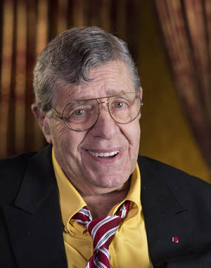 """Photo - This April 14, 2014 photo shows actorr and comedian Jerry Lewis during an interview at TCL Chinese Theatre in Los Angeles. After nearly 70 years in show business, Lewis continues to do standup and serve as leader of the storied Friars Club. On Thursday, he'll host a dinner at the venerable comedy institution to celebrate the 50th anniversary of his film """"The Nutty Professor."""" (Photo by Dan Steinberg/Invision/AP)"""