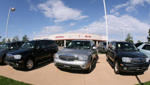 Photo -   RETRANSMISSION TO CORRECT NUMBER OF VEHICLES RECALLED TO 258,000 - FILE - In this Aug. 27, 2006 file photo, a trio of unsold 2006 Buick Rainier sports utility vehicles sits in front of a Buick dealership in the southeast Denver suburb of Lone Tree, Colo. General Motors and Isuzu are recalling more than 258,000 SUVs because the window and door lock switches can cause fires. The recall covers the Chevrolet TrailBlazer, GMC Envoy, Buick Rainier, Isuzu Ascender and Saab 97-X SUVs from the 2006 and 2007 model years. The SUVs were sold or registered in 20 states and Washington, D.C., where salt and other chemicals are used to clear roads in the winter, Saturday, Aug. 18, 2012. (AP Photo/David Zalubowski, File)