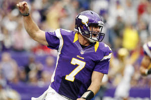photo -   Minnesota Vikings quarterback Christian Ponder (7) celebrates his touchdown run in the first half of an NFL football game against the San Francisco 49ers, Sunday, Sept. 23, 2012, in Minneapolis. (AP Photo/Genevieve Ross)