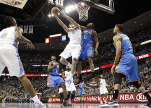 Photo - Denver Nuggets forward Danilo Gallinari (8) from Italy goes up for a shot against Oklahoma City Thunder forward Kevin Durant (35) during the second half in game 4 of a first-round NBA basketball playoff series Monday, April 25, 2011, in Denver. (AP Photo/Jack Dempsey)