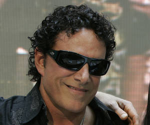 "Photo - FILE - In this March 2, 2009 file photo, Neal Schon poses for a photograph during a news conference at a mall in suburban Quezon City, north of Manila, Philippines.  Schon, the lead guitarist for the rock band Journey has filed a federal lawsuit in Minneapolis that accuses his former mother-in-law of libeling him in her blog posts. Schon says Judy Kozan, the former mayor of Waseca, has ""attacked and harassed"" him for years through Internet postings and comments in the media. Schon's lawsuit says Kozan suggested that he has failed to support his ex-wife and their two daughters. (AP Photo/Aaron Favila)"