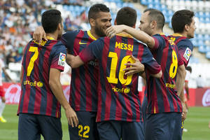 Photo - FC Barcelona's players David Villa, Eric Abidal, Lionel Messi from Argentina and Andres Iniesta, from left to right, celebrate a goal during a Spanish La Liga soccer match against Almeria, in Almeria, Spain, Saturday, Sept. 28, 2013. (AP Photo/Daniel Tejedor)