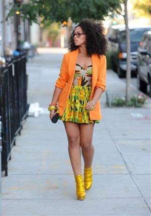 "Photo - This Sept. 18, 2011 publicity photo provided by RCA Records/PictureGroup shows the making of the Sony Music video with Elle Varner featuring J.Cole in the Williamsburg section of New York. When Varner made her debut to the music world with her first music video, she did so in a hand-me-down. ""The jacket I'm wearing in the ""Only Wanna Give It to You"" (music video) was $4 at Good Will,"" she said of the bright orange blazer that got attention on urban blogs when the video was released in 2011. (AP Photo/ RCA Records/PictureGroup, Brad Barket)"