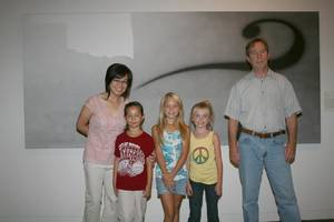"""Photo - Families are invited to Family Day at the Fred Jones Jr. Museum of Art. The free event features art activities and live performances inspired by Ed Ruscha?s painting, """"No Man?s Land,"""" shown in the background.    Photo provided <strong>unknown</strong>"""
