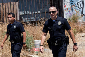 "Photo - Michael Pena, left, and Jake Gyllenhaal in a scene from ""End of Watch.""  OPEN ROAD FILMS PHOTO <strong>Scott Garfield</strong>"