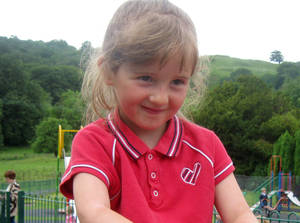 Photo -   This undated photo released by Welsh Dyfed-Powys Police, showing missing five-year old schoolgirl April Jones. 46-year old Mark Bridger, has been charged with the abduction and murder of April Jones, along with perverting the course of justice, according to an announcement by Dyfed-Powys Police in Aberystwyth, Wales, on Saturday Oct. 6, 2012. The disappearance of April Jones sparked a huge search effort with hundreds of local volunteers combing nearby woods and fields, but she remains missing. (AP Photo/Dyfed-Powys Police)