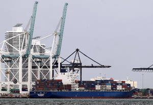 Photo - In this Tuesday, Nov. 13, 2012 photo, the container ship HS Bach is shown docked at the Port of Miami. The U.S. trade deficit expanded in November to its widest point in seven months, driven by a surge in imports that outpaced modest growth in exports. (AP Photo/Wilfredo Lee)