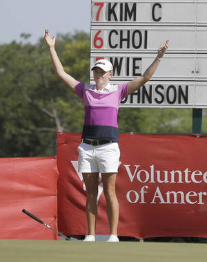 Photo - Stacy Lewis reacts after sinking her putt on the 18th hole and winning the North Texas LPGA Shootout golf tournament at Las Colinas Country Club in Irving, Texas, Sunday, May 4, 2014.  Lewis finished the tourney 16-under to win. (AP Photo/LM Otero)