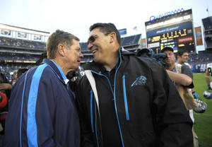 Photo - San Diego Chargers head coach Norv Turner, left,  shakes hands with Carolina Panthers head coach Ron Rivera after an NFL football game Sunday, Dec. 16, 2012 in San Diego. The Panthers won 31-7.  (AP Photo/Denis Poroy)