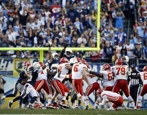 Photo - Kansas City Chiefs kicker Ryan Succop misses the possible game-winning field goal against the San Diego Chargers during the closing seconds of regulation of an NFL football game, Sunday, Dec. 29, 2013, in San Diego. The Chargers eventually won the game 27-24 in overtime. (AP Photo/Lenny Ignelzi)