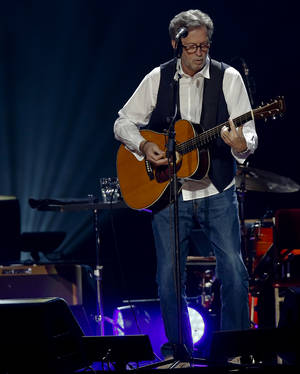 Photo - Eric Clapton performs during his concert at the Chesapeake Energy Arena on Wednesday, March 20, 2013, in Oklahoma City, Okla. Photo by Chris Landsberger, The Oklahoman