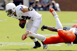 Photo -   Penn State running back Derek Day (24) breaks a tackle by Virginia's Sammy MacFarlane (44) during the first half of an NCAA college football game, Saturday Sept. 8, 2012, in Charlottesville, Va. (AP Photo/Andrew Shurtleff)