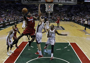 Photo - Miami Heat's LeBron James (6) shoots during the first half of Game 3 in their first-round NBA basketball playoff series against the Milwaukee Bucks, Thursday, April 25, 2013, in Milwaukee. The Heat won 104-91 to take a 3-0 lead in the series. (AP Photo/Morry Gash)