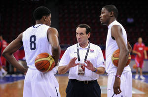 Photo - US coach Mike Krzyzewski, center, talks with Rudy Gay, left, and Kevin Durant during practice last Thursday. AP PHOTO