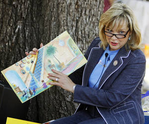 Photo - Gov. Mary Fallin reads to children during Septemberfest at the Governor's Mansion in Oklahoma City, Saturday, Sept. 10, 2011. Photo by Nate Billings, The Oklahoman  ORG XMIT: KOD
