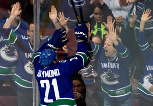 Photo - Vancouver Canucks' Mason Raymond celebrates his goal against the Los Angeles Kings during the second period of an NHL hockey game in Vancouver, British Columbia on Saturday, March 2, 2013. (AP Photo/The Canadian Press, Darryl Dyck)