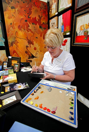 Photo - ARTWORK: Artist Betsy Cofer, Bethany, paints as she displays her art during May Fair at Andrews Park  on Friday, April 29, 2011 Norman, Okla.   Photo by Steve Sisney, The Oklahoman ORG XMIT: KOD