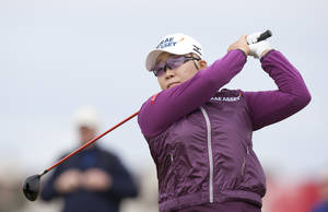 Photo -   South Korea's Jiyai Shin drives off the fourth tee at the Women's British Open golf championships at Royal Liverpool Golf Club, Hoylake, England, Sunday Sept. 16, 2012. (AP Photo/Jon Super)