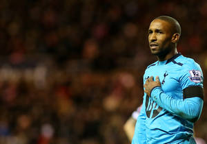 Photo - Tottenham Hotspurs' Jermain Defoe is seen wearing a black armband as a sign of respect to mark the life of former South African President Nelson Mandela, during their English Premier League soccer match against Sunderland at the Stadium of Light, Sunderland, England, Saturday, Dec. 7, 2013. (AP Photo/Scott Heppell)