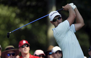 Photo - Henrik Stenson, of Sweden, hits from the tee on the 14th hole during the second round of play in the Tour Championship golf tournament at East Lake Golf Club in Atlanta, Friday, Sept. 20, 2013. (AP Photo/John Bazemore)