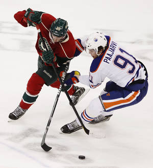 photo - Minnesota Wild defenseman Jonas Brodin (25), of Sweden, battles for possession against Edmonton Oilers left wing Magnus Paajarvi (91), of Sweden, during the first period of an NHL hockey game Sunday March 3, 2013 in St. Paul, Minn. (AP Photo/Genevieve Ross)