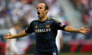 Photo - Los Angeles Galaxy's Landon Donovan celebrates after scoring a goal against the Vancouver Whitecaps during the first half of an MLS soccer game in Vancouver, British Columbia, Saturday, Aug. 24, 2013. (AP Photo/The Canadian Press, Darryl Dyck)
