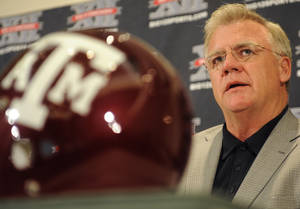 Photo - Texas A&M coach Mike Sherman speaks to reporters during Big 12 Media Days on Monday in Irving, Texas. AP PHOTO