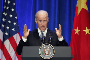 Photo - U.S. Vice President Joe Biden delivers a speech during a business leaders breakfast at The St. Regis Beijing hotel in Beijing Thursday, Dec. 5, 2013. (AP Photo/Lintao Zhang, Pool)