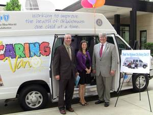 Photo - Patrick Raglow, executive director at Catholic Charities Oklahoma City, Brooke Townsend, manager of the Oklahoma Caring Foundation, and Robert Clements, executive vice president at Clements Foods, with the Caring Van made possible by Oklahoma City Rotary Club 29. Raglow and Clements are Rotarians.  Photo provided <strong>PROVIDED</strong>