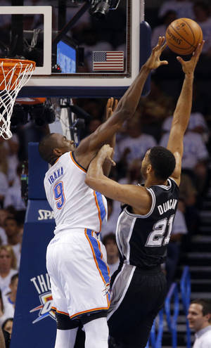 Photo - Oklahoma City's Serge Ibaka (9) defends against San Antonio's Tim Duncan (21) during Game 6  in the first round of the NBA playoffs between the Oklahoma City Thunder and the Memphis Grizzlies at FedExForum in Memphis, Tenn., Thursday, May 1, 2014. Photo by Bryan Terry, The Oklahoman