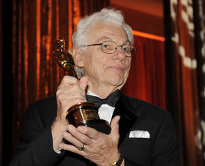 Photo - FILE - In this Nov. 14, 2009 file photo, cinematographer Gordon Willis poses with his honorary Oscar following The Academy of Motion Picture Arts and Sciences 2009 Governors Awards in Los Angeles. An official at the Chapman Cole & Gleason funeral home in Falmouth, Mass. on Monday, May 19, 2014 confirmed that Willis, one of Hollywood's most celebrated and influential cinematographers, has died. He was 82. (AP Photo/Chris Pizzello, File)