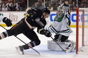 Photo - Anaheim Ducks right wing Emerson Etem, left, scores on Dallas Stars goalie Jack Campbell during the second period of their NHL hockey game, Sunday, Oct. 20, 2013, in Anaheim, Calif. (AP Photo/Mark J. Terrill)