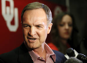 Photo - OU head men's basketball coach Lon Kruger answers questions from the media after a watch party for the NCAA basketball tournament selection show, at Lloyd Noble Center in Norman, Okla., Sunday, March 17, 2013. Oklahoma was selected as the 10th seed in the South Region. Photo by Nate Billings, The Oklahoman