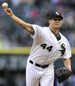 Photo - Chicago White Sox starter Jake Peavy delivers a pitch during the first inning of an interleague baseball game against the Miami Marlins in Chicago, Saturday, May 25, 2013. (AP Photo/Paul Beaty)
