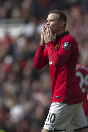 Photo - Manchester United's Wayne Rooney celebrates after scoring a penalty against Aston Villa, during their English Premier League soccer match at Old Trafford Stadium, Manchester, England, Saturday March 29, 2014. (AP Photo/Jon Super)