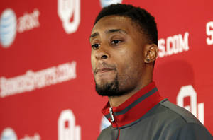 Photo -                    Aaron Colvin of Oklahoma will wait to hear his name called in this weekend's NFL Draft.                                                                             Photo by Nate Billings, The Oklahoman