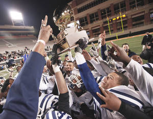 Photo - Star Spencer celebrates its Class 4A title after defeating Douglass on Saturday at Boone Pickens Stadium.  Photo by Nate Billings, The Oklahoman
