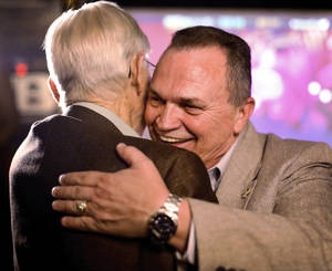 Photo - John Whetsel hugs Al Snipes, of Oklahoma City, at his watch party Tuesday in Choctaw. Photo by Jim Beckel, The Oklahoman