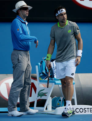 Photo - Spain's David Ferrer, right, stands by a line judge after he pushed the linesman away so he could lay his towel on the judge's chair during his quarterfinal loss to Tomas Berdych of the Czech Republic at the Australian Open tennis championship in Melbourne, Australia, Tuesday, Jan. 21, 2014.(AP Photo/Aaron Favila)