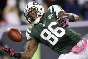 photo -   New York Jets tight end Jeff Cumberland (86) catches a touchdown pass during the first half of an NFL football game against the Houston Texans, Monday, Oct. 8, 2012, in East Rutherford, N.J. (AP Photo/Kathy Willens)
