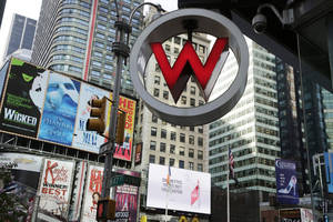 Photo - FILE  - In this Wednesday, July 31, 2013, file photo, a W Hotel is located in Times Square, in New York.  The luxury hotel is owned by Starwood Hotels & Resorts Worldwide, who reports earnings on Thursday, Feb. 13, 2014. (AP Photo/Mark Lennihan)