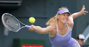 photo -   Maria Sharapova of Russia returns a shot to Lucie Safarova of the Czech Republic during their third round match of the Japan Pan Pacific Open tennis tournament in Tokyo, Wednesday, Sept. 26, 2012. (AP Photo/Shizuo Kambayashi)