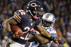 Photo -   Chicago Bears running back Matt Forte (22) is pursued by Detroit Lions safety Erik Coleman (24) in the second half of an NFL football game in Chicago, Monday, Oct. 22, 2012. (AP Photo/Nam Y. Huh)