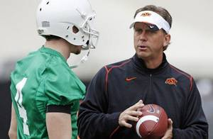 Photo - Oklahoma State offensive coordinator Todd Monken told The Oklahoman he has not interviewed to be the next head coach at Illinois, contrary to multiple reports. PHOTO BY NATE BILLINGS, The Oklahoman Archive <strong>NATE BILLINGS</strong>