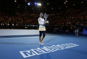 Photo - Victoria Azarenka of Belarus holds her trophy after winning the women's final against China's Li Na at the Australian Open tennis championship in Melbourne, Australia, Saturday, Jan. 26, 2013. (AP Photo/Andy Wong)