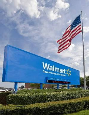 photo - This undated file photo provided by Walmart Stores Inc., shows the company&#039;s sign in front of their Bentonville, Ark., headquarters. Walmart Stores Inc. announced a program Thursday, June 3, 2010, in which its workers can receive college credit from the online American Public University and receive a tuition discount from the school.(AP Photo/ Walmart Stores Inc., File)