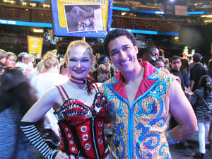 Photo - In this undated family photo, Samantha Pitard, left, poses for a photo with Andrey Medeiros. Pitard was one of eight acrobats performing a hair-hanging stunt on Sunday, May 4, 2014, during a Ringling Bros. and Barnum & Bailey circus when a clip at the top of the chandelier-like apparatus snapped. Pitard was the first of the acrobats to be released from the hospital. (AP Photo/Wayne T. Pitard)