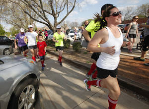 Photo - Edmond runners begin a three-mile run through Edmond Monday in honor of the Boston Marathon bombing victims. PHOTOs BY DAVID MCDANIEL, THE OKLAHOMAN